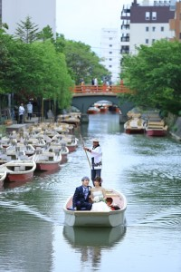 couple ride on boar in Yanagawa