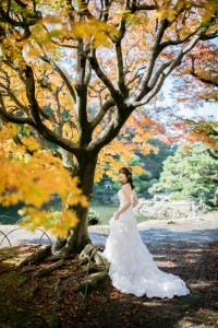 Bride standing under the maple leaves
