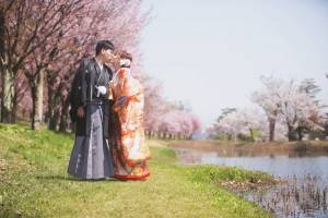 Beautiful sakura and happy couple