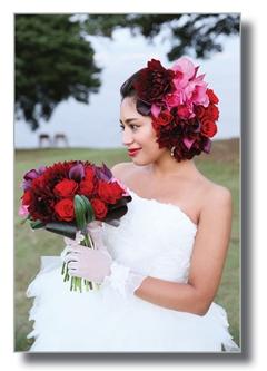 Bride is grabbing fresh flower bouquet