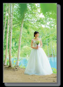 Bride at blue pond in Hokkaido